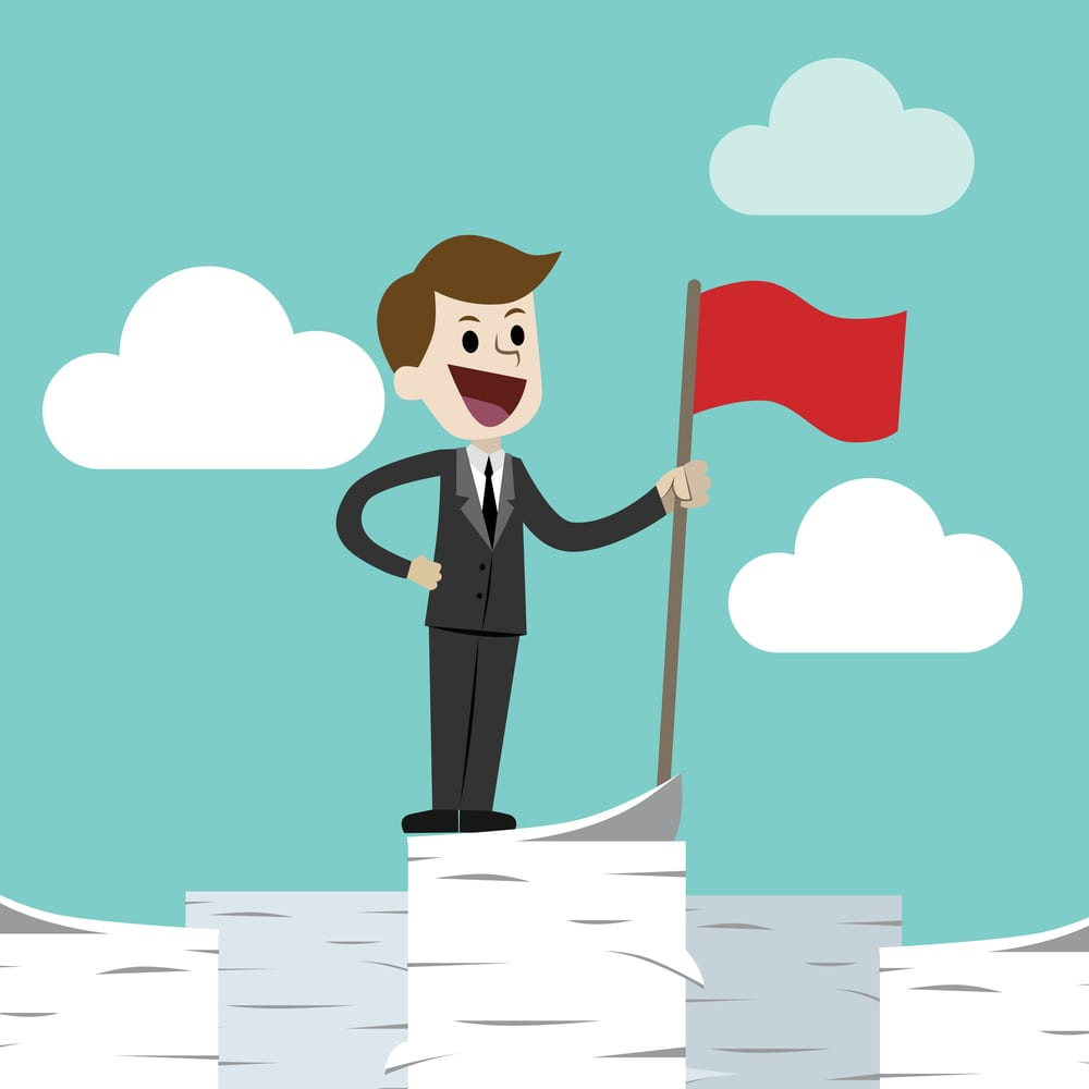 Business man standing on a huge tower stack of papers and handing red flag. Job is finished successful