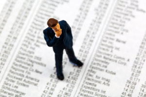 business man figure on stock prices, symbol photo for finance, speculation, investment