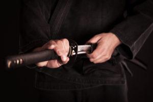ninja holding a sword in the waist